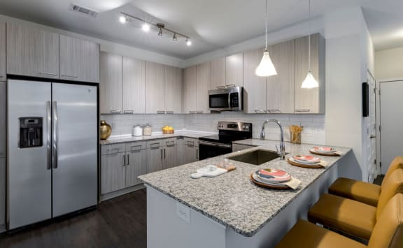 Fitted Kitchen With Island Dining at Berkshire Chapel Hill, Chapel Hill, North Carolina