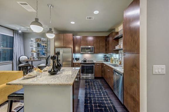 Kitchen Bar With Granite Counter Top at Berkshire Auburn, Texas