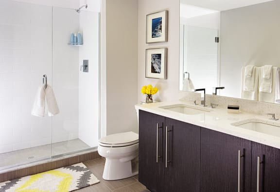 Spa Baths with Frameless Glass Shower, Beautiful Ebony Vanity with Dual Sinks, Large Mirrors and Hard Surface Flooring at Gatehouse 75, Charlestown, MA, 02129