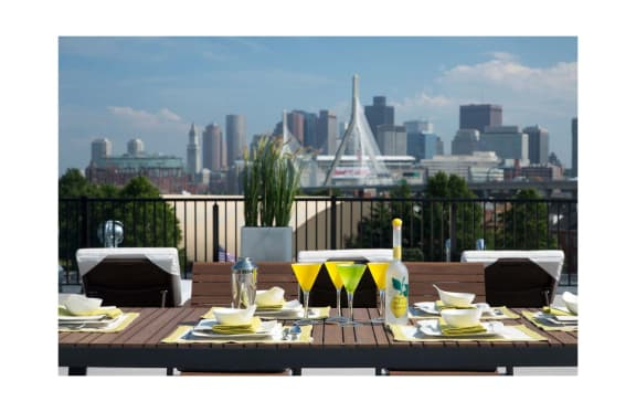 Select 1 and 2 Bedroom Apartments Feature Private Balcony with Boston Seaport and City Skyline Views at Gatehouse 75, Charlestown, MA