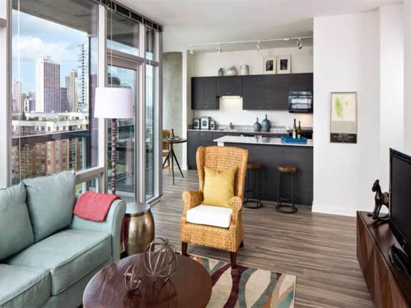 Open Concept Living and Kitchen with Chicago Skyline Views, Eight O Five Apartments