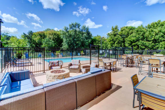 Outdoor Living Room with Pool and Alfresco Dining-Berkshire Central Apartments Blaine MN