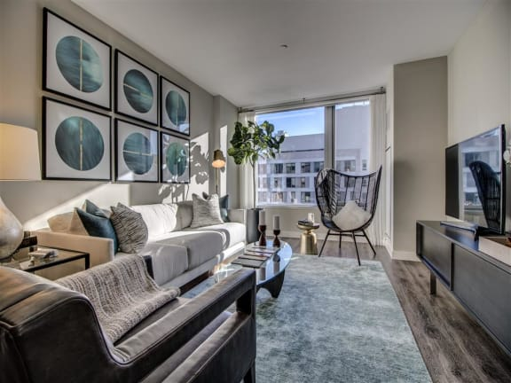 Living Room With Expansive Window at Via Seaport Residences, Boston, Massachusetts