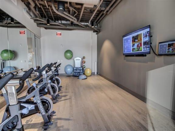 Peloton Bike And Training Space at Via Seaport Residences, Massachusetts