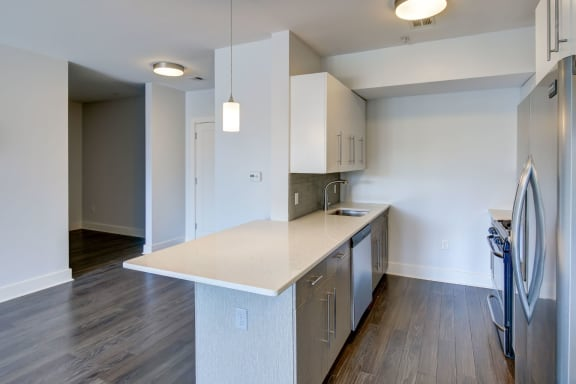 Luxury Apartments Charlestown MA with New Chef's Kitchen with Peninsula with Quartz Counters and Stainless Appliances-Gatehouse 75 Apartments