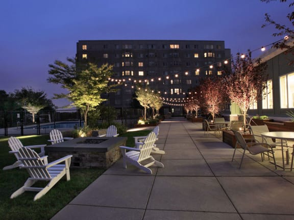 Outdoor Living Green Space with Firepit and Outdoor Movies--HighPoint Apartments Quincy MA