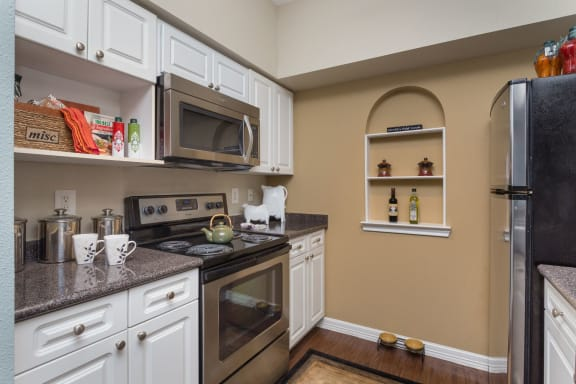 Fully Equipped Kitchen With Modern Appliances at The Plaza Museum District, Houston, Texas