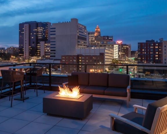 Deck View at The Maven on Broadway New Luxury Apartments in Downtown Rochester MN 55904 featuring Skydeck with Firepit and Stunning City Skyline Views