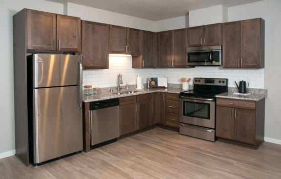 Brand New Luxury Studio, 1, 2 and 3 Bedroom Apartments with Chefs Kitchen and In-Home Washer/Dryer-Berkshire Central- 9436 Ulysses Street NE Blaine, MN. 55434
