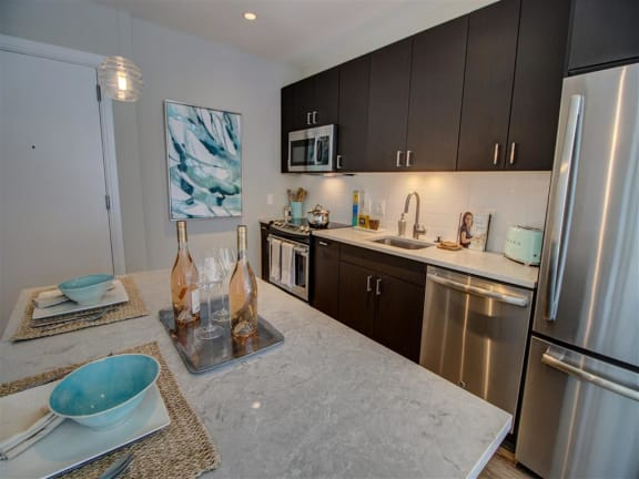 Fitted Kitchen With Island Dining at Via Seaport Residences, Massachusetts