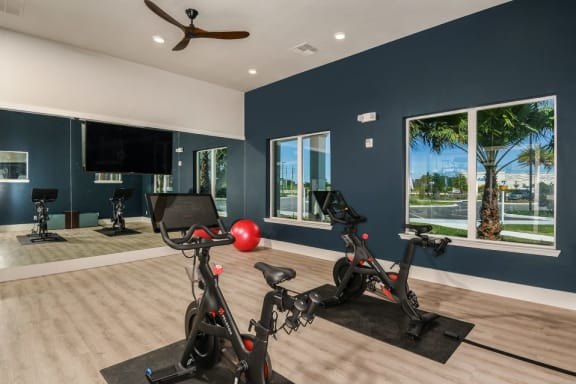 yoga room with peloton bikes at Luminary at 95 apartments West Melbourne FL