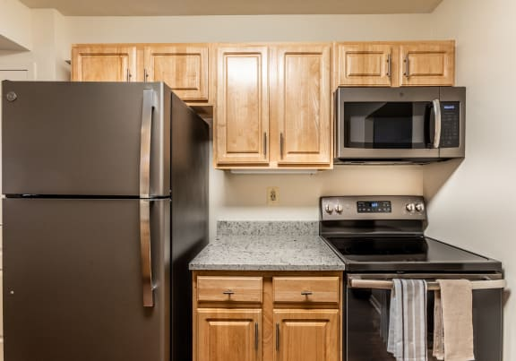 Renovated kitchens with slate appliances at Ivy Hall Apartments in Towson MD
