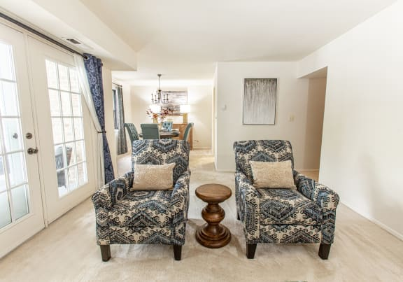 Living room that leads out onto a private balcony or patio