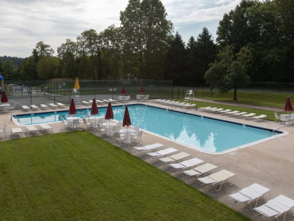 Large swimming pool with lounge area at Cromwell Valley Apartments in Towson, MD