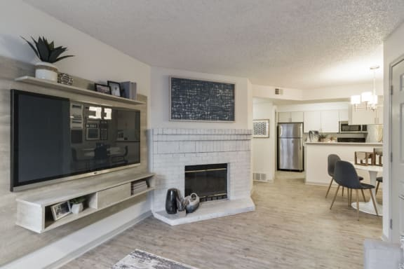 Living Room With Standard Fireplace at Alvista Trailside Apartments, Englewood