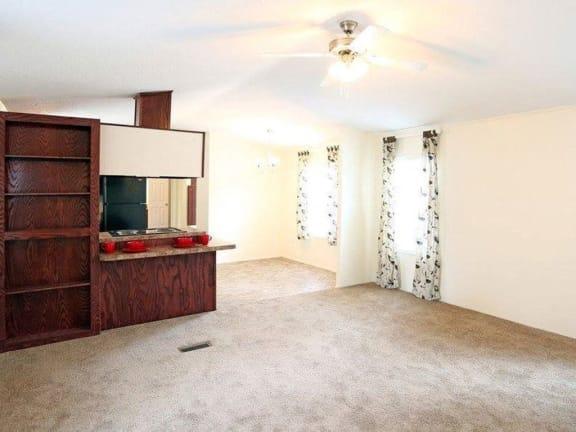 Carpeted Flooring in Living Room at Heritage Oaks Rental Homes in Sanford, NE