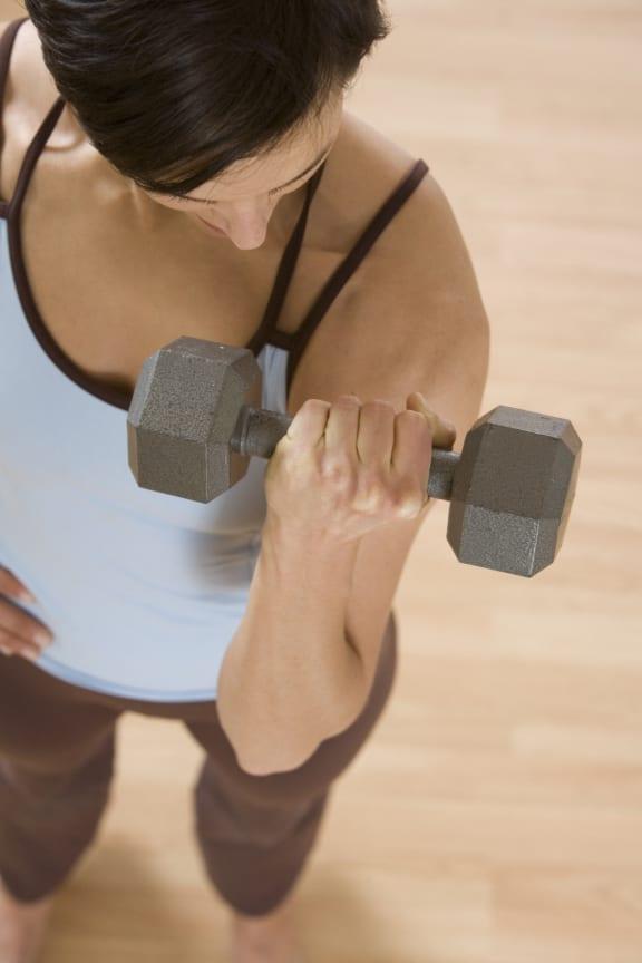 woman lifting dumbbell_Ashton at Richmond Hill, Richmond Hill, GA