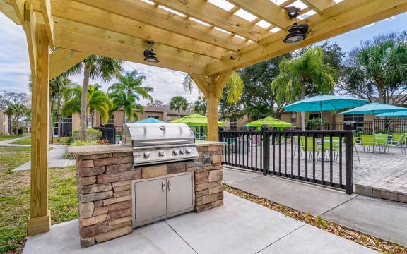 outdoor grilling area by pool
