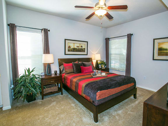 Spacious Model Bedroom with Carpeting and Ceiling Fan in Fairfield Apartments Near Me