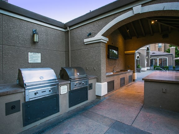 Covered Outdoor Kitchen and Bar with BBQ Grill at Suisun Apartments