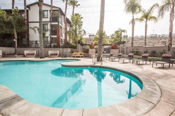 Pool with Lounge Chairs  l Slymar CA Apartments For Rent