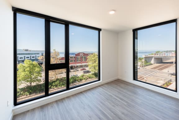 Living Room Features Large Windows and Beautiful Views at 10 Clay Apartments in Seattle, Washington, 98121