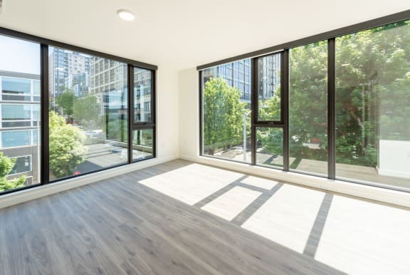 Master Bedroom With Spacious Interiors and Large Windows at 10 Clay Apartments in Seattle, Washington