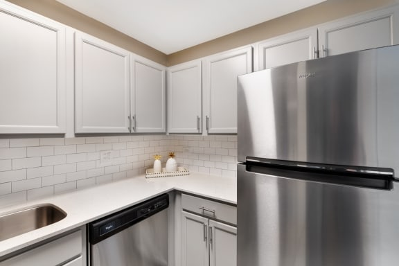 Kitchen With White Cabinetry And Appliances at The Ponds of Naperville, Naperville