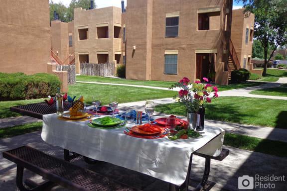 Picnic tables for residents at apartments near Santa Fe mall