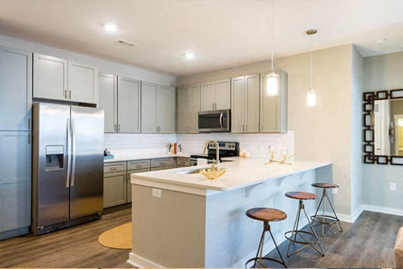 Fitted Kitchen With Island Dining at Central Island Square, Daniel Island