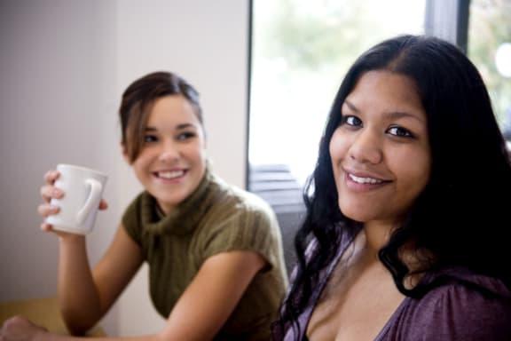 women having coffee_Carlton Court / Metro Hollywood Apartments Los Angeles, CA