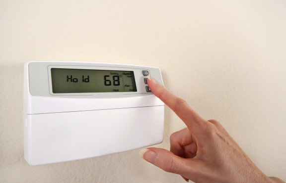 Person using the AC electronic thermostat-Preservation Square, St. Louis, MO