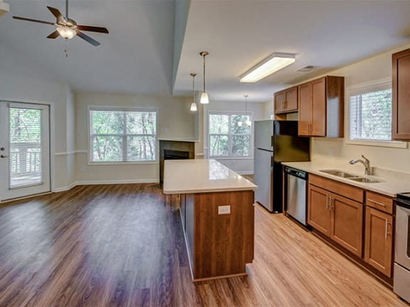 Lighted Ceiling Fan in Living Room at Cambridge Apartments, Raleigh, 27615
