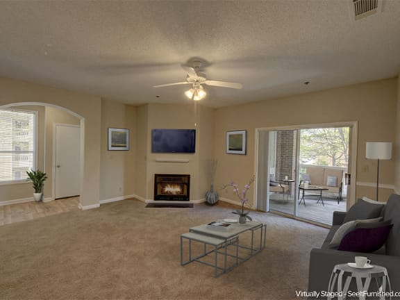 Living Room with Fireplace at Cambridge Apartments, Raleigh, NC
