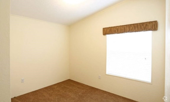 Bedroom With Carpeted Flooring and Window at Valley Ridge Rental Homes in San Antonio, Texas 78242
