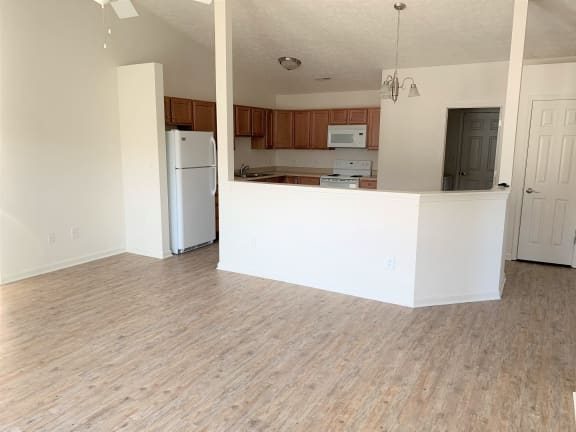 Living Room into Kitchen - upgraded flooring  at Hawthorne Properties, Indiana