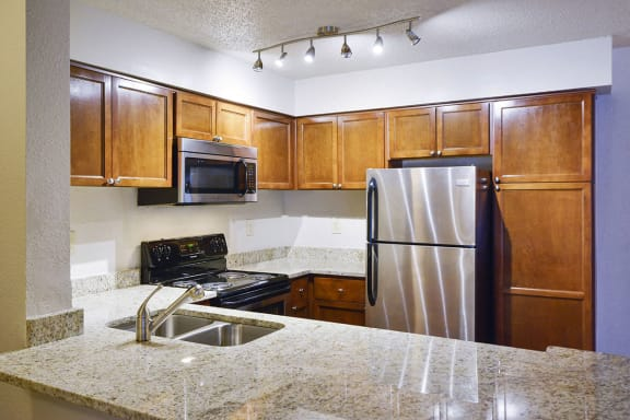 Upgraded Kitchen with Granite Countertops at Duluth Apartments Near Me