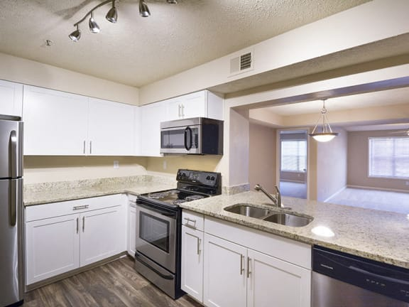 Large Kitchen with European-Style Cabinetry at Smyrna, GA Apartment Near North Cooper Lake Park