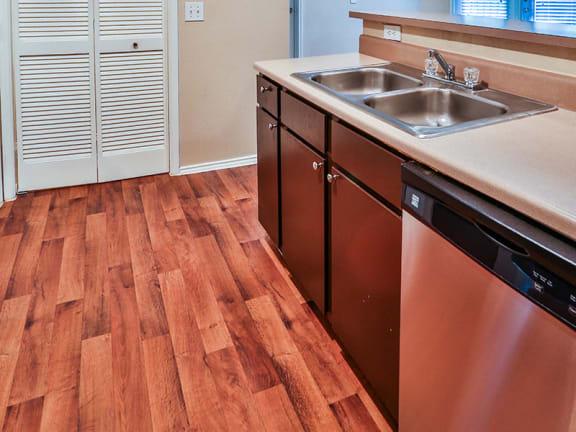 Kitchen with Dishwasher at MacArthur Ridge Apartments near DFW Airport