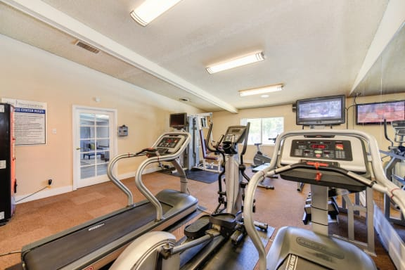 Fitness Center with Treadmills, TV and Vending Machine.