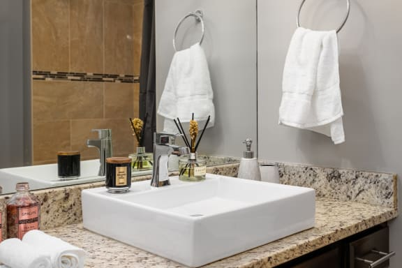 Renovated Bathrooms With Quartz Counters at Somerset Place Apartments, Chicago