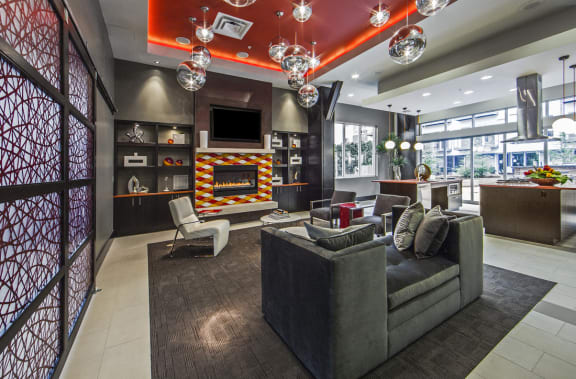 Spacious Clubroom with Fireplace, Chefs Kitchen, & Entertainment Center.