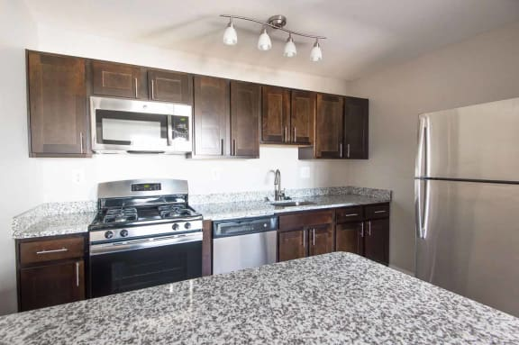 Gourmet Kitchen with Breakfast Bar and Pantry at Kenilworth at Perring Park Apartments, 8951 Waltham Woods Road