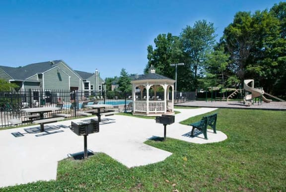 Garden Courtyard with Grills and Fireplace at The Crossings at White Marsh Apartments, Perry Hall, Maryland