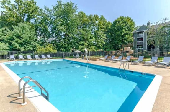 Swimming Pool Area with Shaded Chairs at The Crossings at White Marsh Apartments, Perry Hall, Maryland
