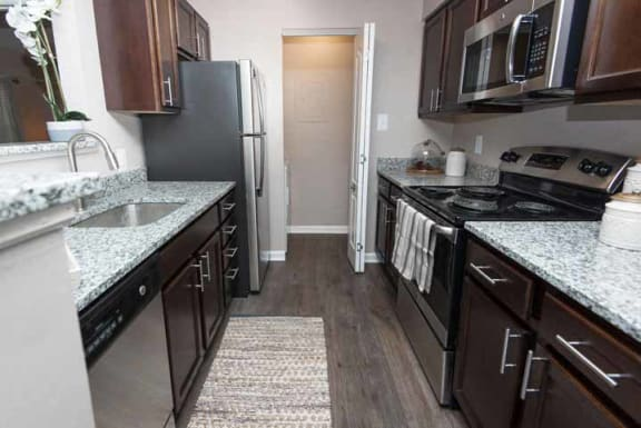 Refrigerator and Kitchen Appliances at The Crossings at White Marsh Apartments, Maryland