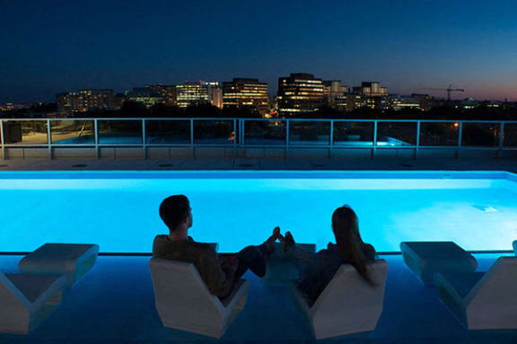 Verde Point's rooftop pool at Night