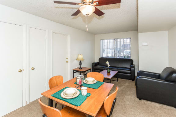 Pine View Village Shared Living Furnished with Couch, Chair, Coffee Table, Kitchen Table and Four Chairs