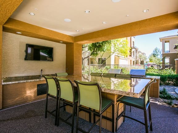 Outdoor Kitchen and Poolside BBQ at Mesa AZ Apartment Near Boeing