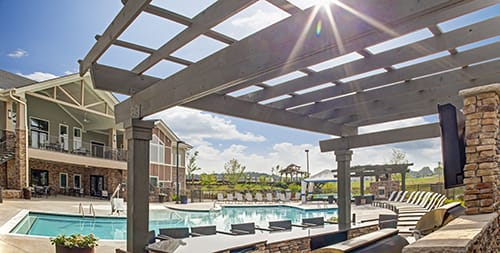 Swimming pool with sun deck at LangTree Lake Norman Apartments, Mooresville, NC